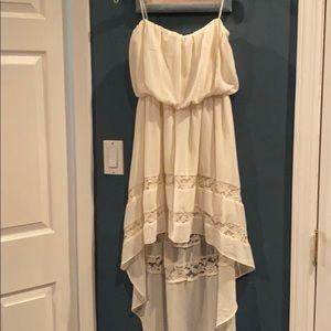 Sleeveless cream cocktail dress
